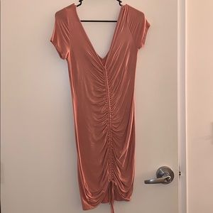 Blush pink middle scrunch dress with ties.